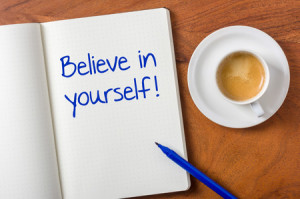 34064022 - notebook on a desk - believe in yourself