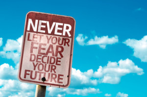 55756329 - never let your fear decide your future sign with clouds and sky background